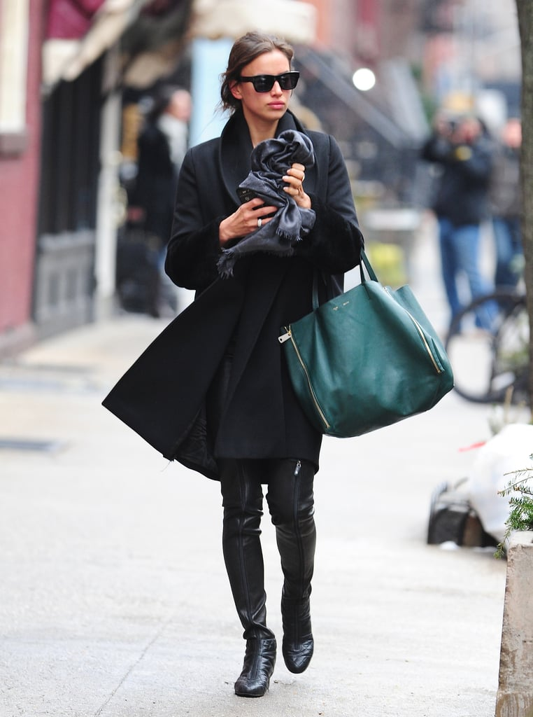 Irina Shayk (smartly) used an emerald-green leather tote to up the ante on her all-black look in NYC.