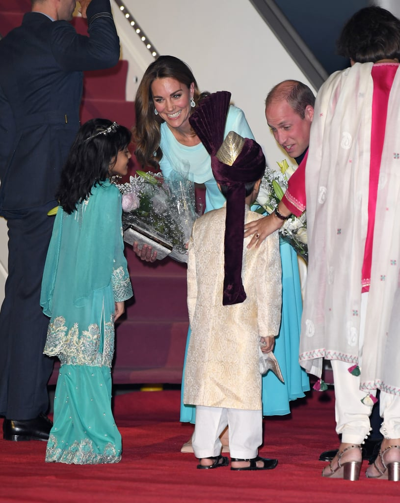 Kate and Will Receive Flowers From Young Royal Admirers as They Kick Off Pakistan Tour