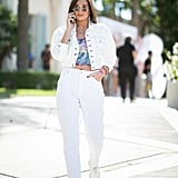 With a Cropped Denim Jacket, Colorful Crop Top, and White Plimsolls