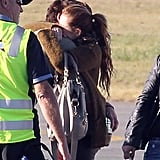 Miley Cyrus and Liam Hemsworth embraced at the airport in Brisbane, Australia, in June 2011.