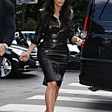 Instead of a lighter-weight Summer cotton, Kim suited up in a leather button-down and matching leather pencil skirt for lunch in Paris.