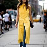 Give a Bright Summer Dress New Life By Styling Over Loose Denim