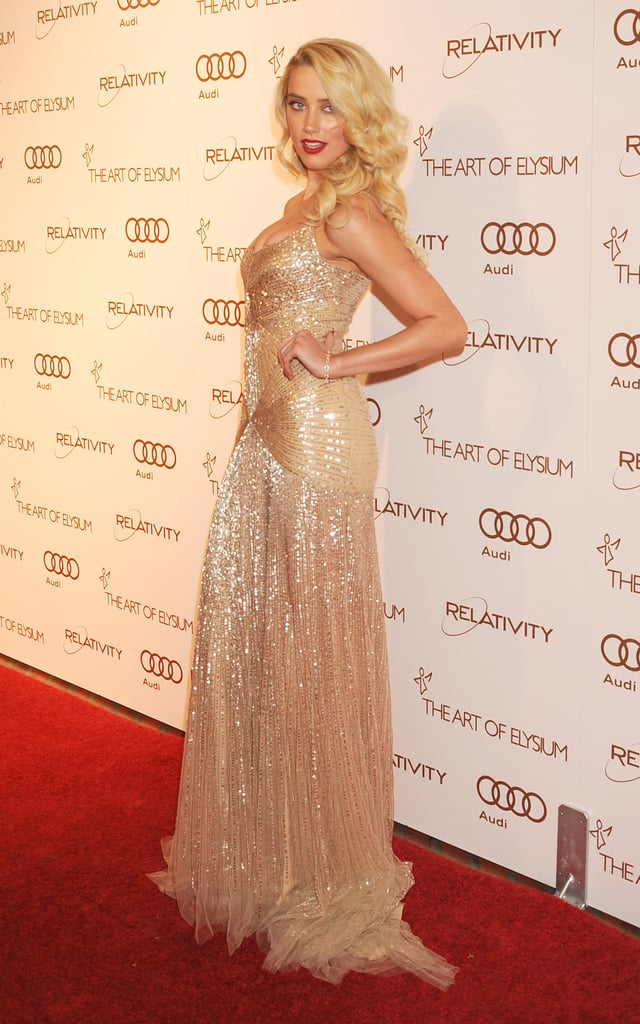 Amber Heard had another major bombshell moment in a gold sequined gown and matching tresses at the Art of Elysium's Heaven gala in LA in January 2012.