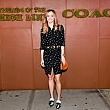 Suki Waterhouse nailed easy Summer dressing in a printed shirtdress and white and black brogues from Coach.