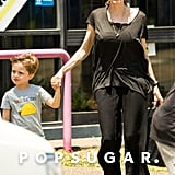 Angelina Jolie held hands with Knox when she brought her little ones along to shop for Halloween decorations on Saturday.