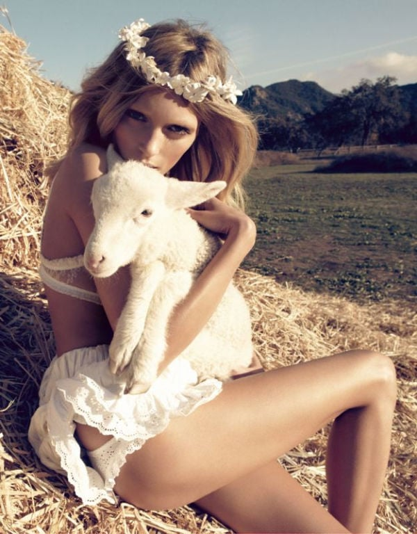 Anja Rubik has another cuddly moment, with a lamb.