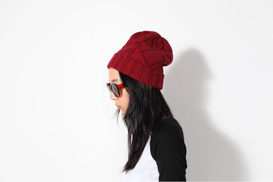 This cool girl gets her flair courtesy of a Mikkat Market red cable-knit beanie ($19), and if you're loving it, you can too.