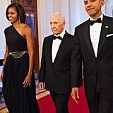 Michelle wore a black, one-shoulder Michael Kors gown with gorgeous drop earrings by House of Lavande.