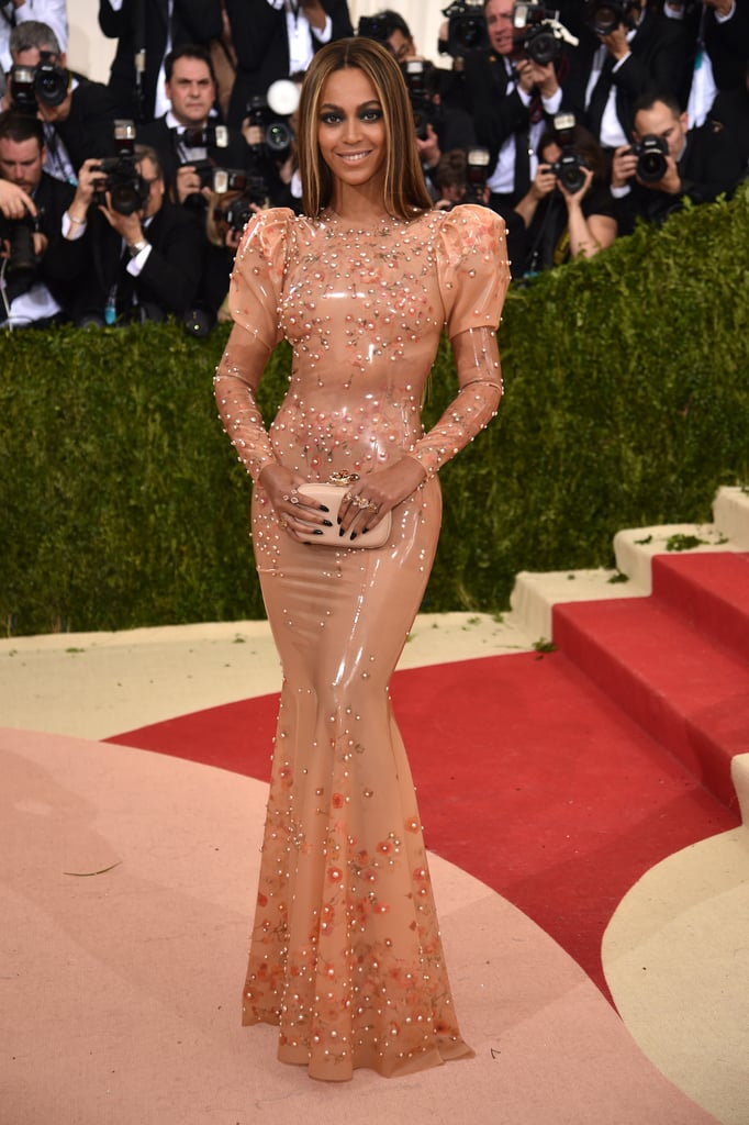 """Beyoncé gave us a glimpse of her Met Gala look via Instagram on Monday night before arriving at the main event, putting her curves on display in a latex-like Givenchy gown. The singer, who paused from her Formation World Tour to pop up in the Big Apple, shared a social media snap of herself in that secretive space she's been known to take photos and, much like last year, let us know that she was planning to hit the red carpet and gave us some time to get ourselves in formation. While walking the famous staircase and speaking to reporters, Beyoncé said of her dress, """"It's actually a lot easier than last year."""" Whatever you say, queen!  Inside, Beyoncé mixed and mingled with stars like Madonna, Amy Schumer, Odell Beckham, Jr., Aziz Ansari,and Joan Smalls. She also reunited with her Obsessed costar Idria Elba, linked up with her pal Nicki Minaj and little sister, Solange, and celebrated with Balmain designer Olivier Rousteing at his afterparty, which was held at the Gilded Lily. Dare we say Beyoncé had the time of her life? Keep reading to see Beyoncé's solo outing at this year's Met Gala."""