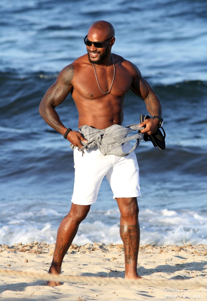 Tyson Beckford showed off his shirtless body on the beach in Ibiza on Friday. The model took a walk across the sand after taking off his tank top and happily snapped selfies with fans (and a few solo shots of himself). During his time in the bustling tourist destination, Tyson linked up with Paris Hilton for a party that the socialite was DJing; he shared a snap of them in the DJ booth on Instagram from the Amnesia nightclub. Check out more of Tyson's hottest photos.