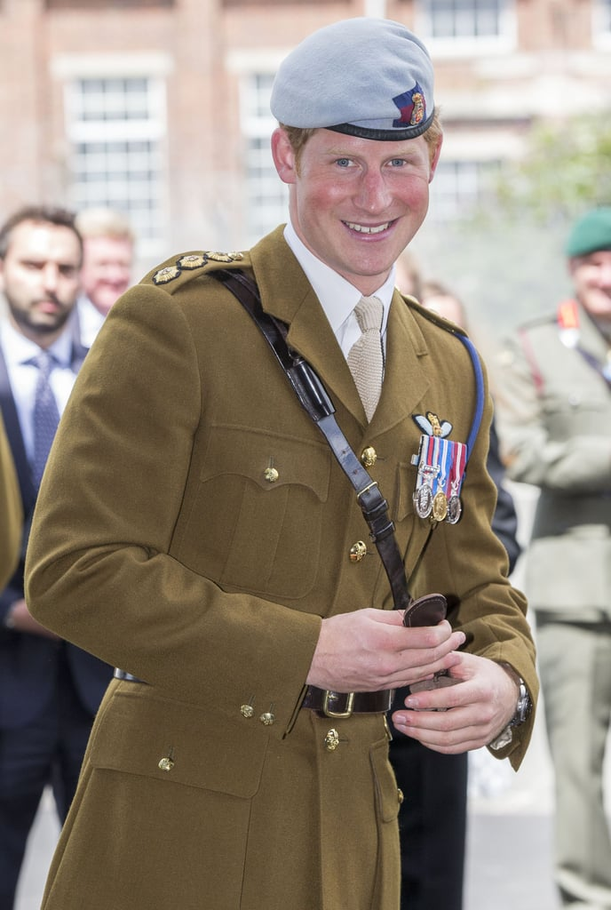 Prince Harry flashed a grin after cutting the ribbon to open a new center at the naval base.