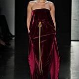 Closing Prabal Gurung's show in a red velvet dress by the designer.