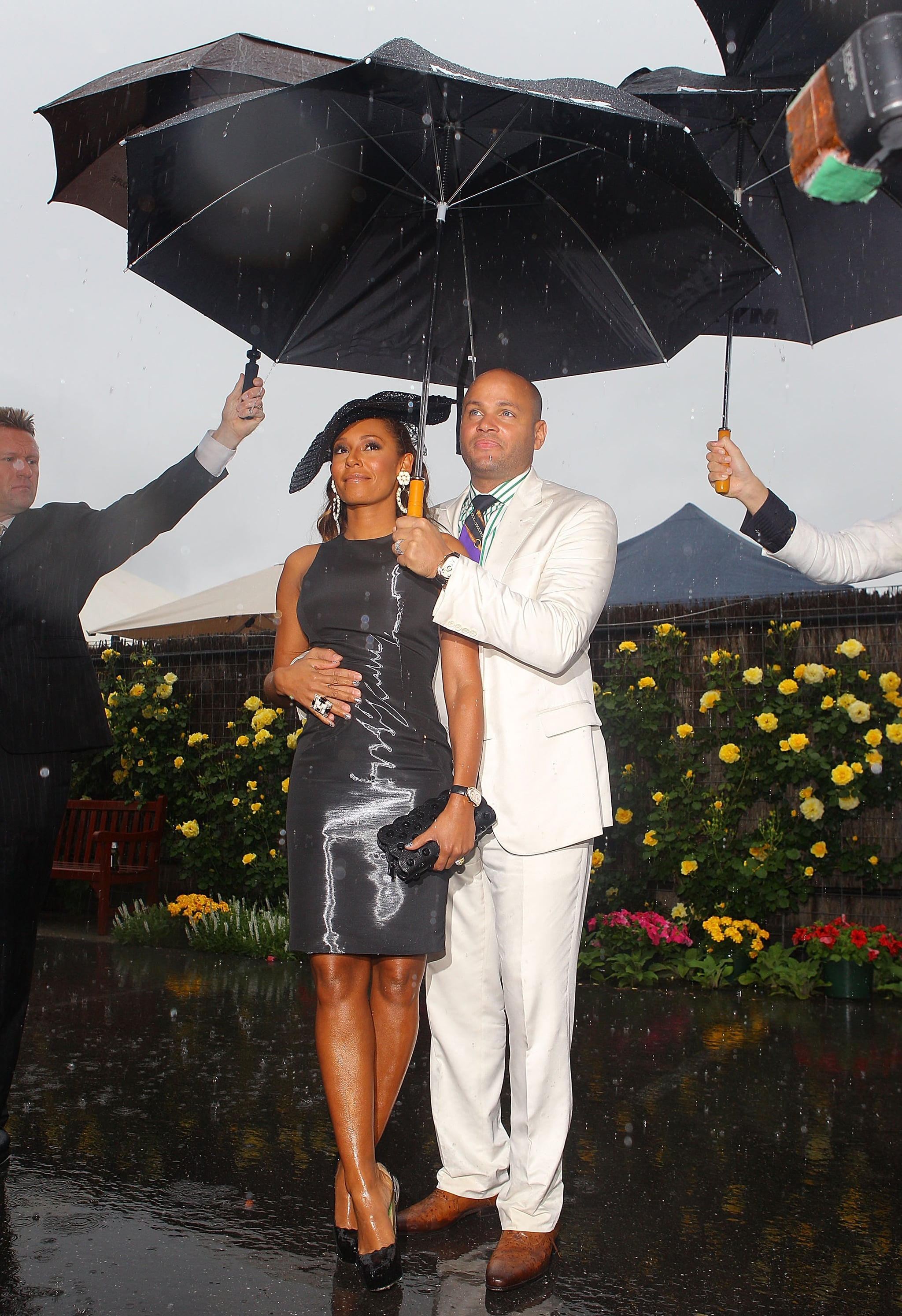 Mel B withstands the showers