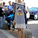 Mickey Mouse never looked quite so styled, with bold-hued add-ons and a lacy LWD layered up underneath.
