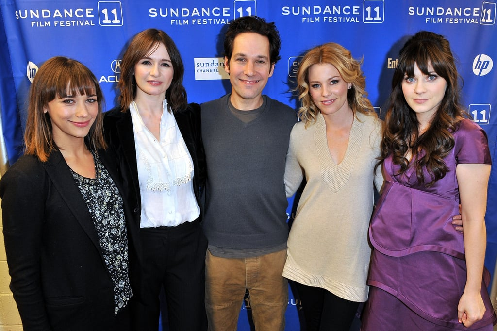 My Idiot Brother is one of the most anticipated movies at Sundance this year, and last night the star-studded cast stepped out for their big premiere. Paul Rudd is at the center of this quirky comedy, which both Becky from Buzz and I thoroughly enjoyed and was picked up by The Weinstein Company already. During a Q&A after the film, he joked about working so many times with Elizabeth Banks, who plays one of his sisters in the project. She stayed warm in a chic Burberry coat while Zooey Deschanel dared to wear a little Marc Jacobs dress and H&M heels despite the freezing temperatures and icy conditions. Zooey and Rashida Jones play a couple in My Idiot Brother and both women had nothing but glowing things to say about each other. Emily Mortimer revealed that she loves that she doesn't have to get dressed up for Sundance and joked about how fun it is that the altitude makes you get drunk very easily. Once they were done with their audience Q&A, the cast was off to their afterparty at the Bing bar  — keep track of all the festival news on Buzz and stay tuned for lots more on PopSugar Rush!