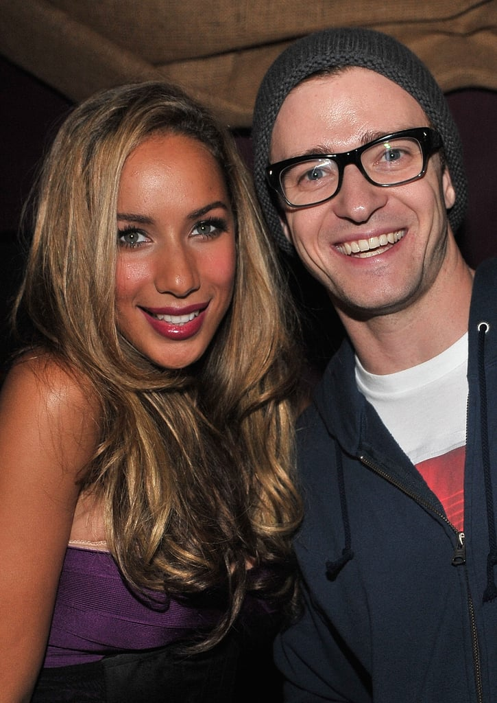 Looking hot in glasses and a beanie, Justin Timberlake posed with Leona Lewis at her album release party in 2009.