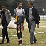 Barack chatted with his daughters after returning from their Hawaiian vacation in January 2014.