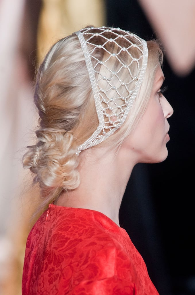 And the hair at Ulyana Sergeenko was a french braid that ended in a fishtailed chignon. Beaded headbands completed the style.