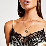 River Island Taurus zodiac sign gold color necklace