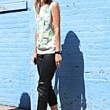 A flirty top and statement heels got tempered with ankle-crop leather pants.