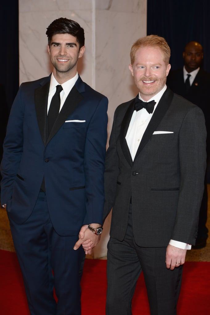 Husbands Jesse Tyler Ferguson and Justin Mikita held hands on the red carpet.