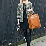 A bit of camo juxtaposed pretty pleats, while a leather tote anchored the whole look.