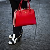 Red Prada met black and white heels.