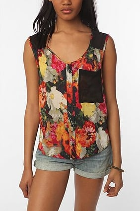 A sheer floral tank to pair with shorts or a denim midi skirt.  Silence & Noise Floral Block Blouse ($54)