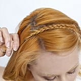 Lay the braid down on top of your head. Make sure that the rest of your hair is pulled back underneath the plait.