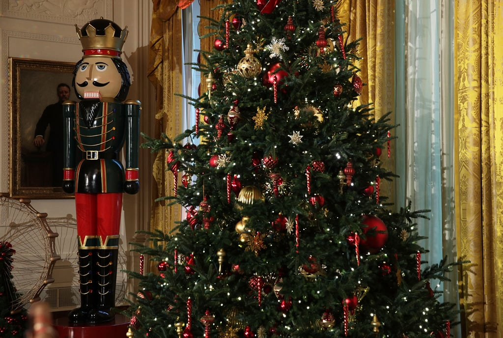 a larger than life nutcracker stands guard over the christmas tree in the east