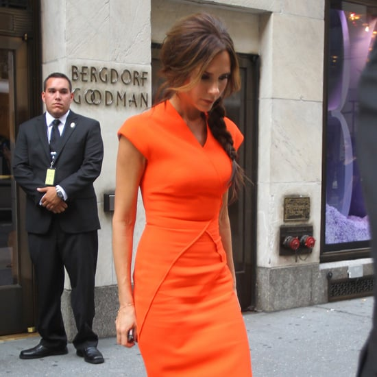 Victoria Beckham Wearing Orange Dress