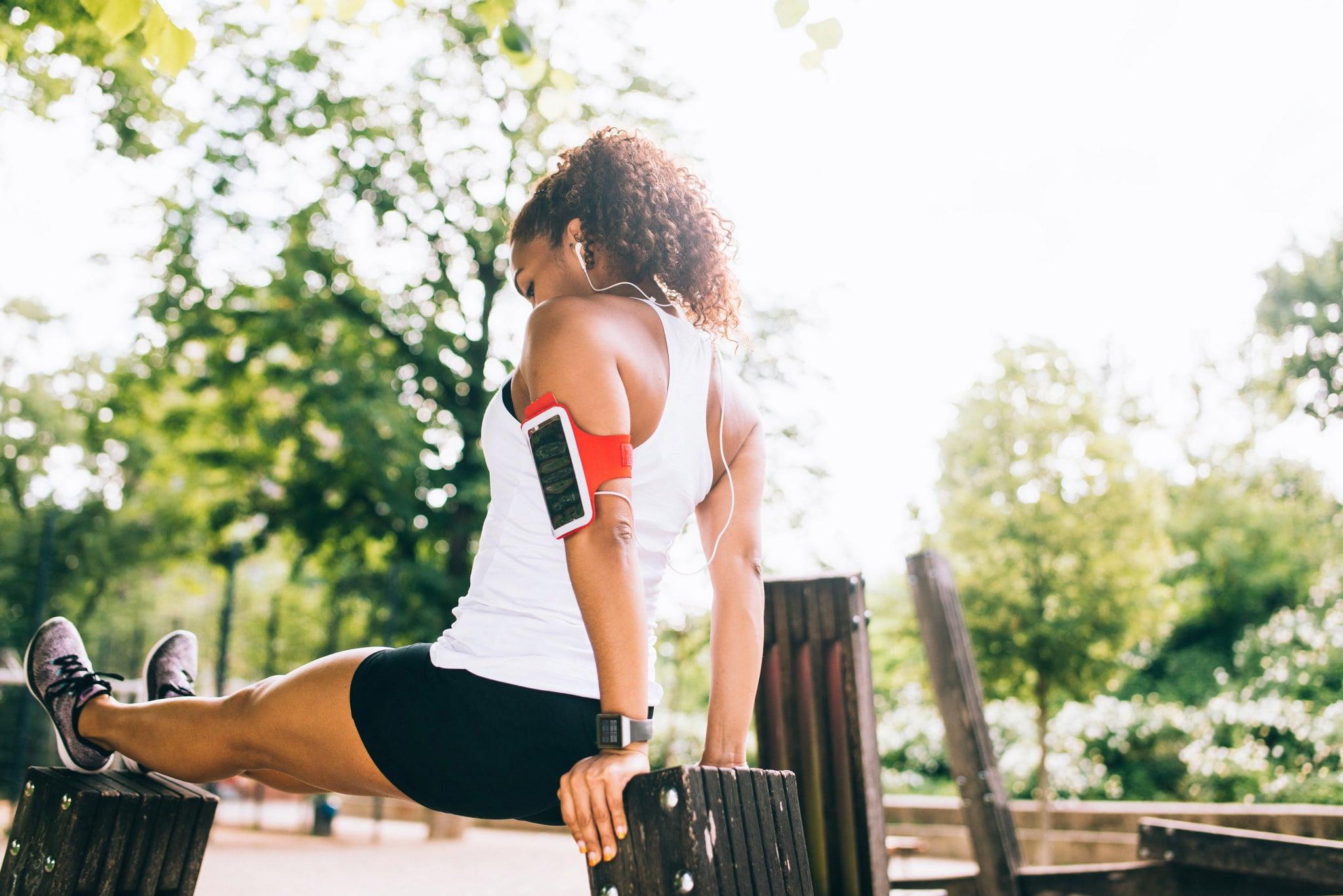 Woman doing dips outdoor.