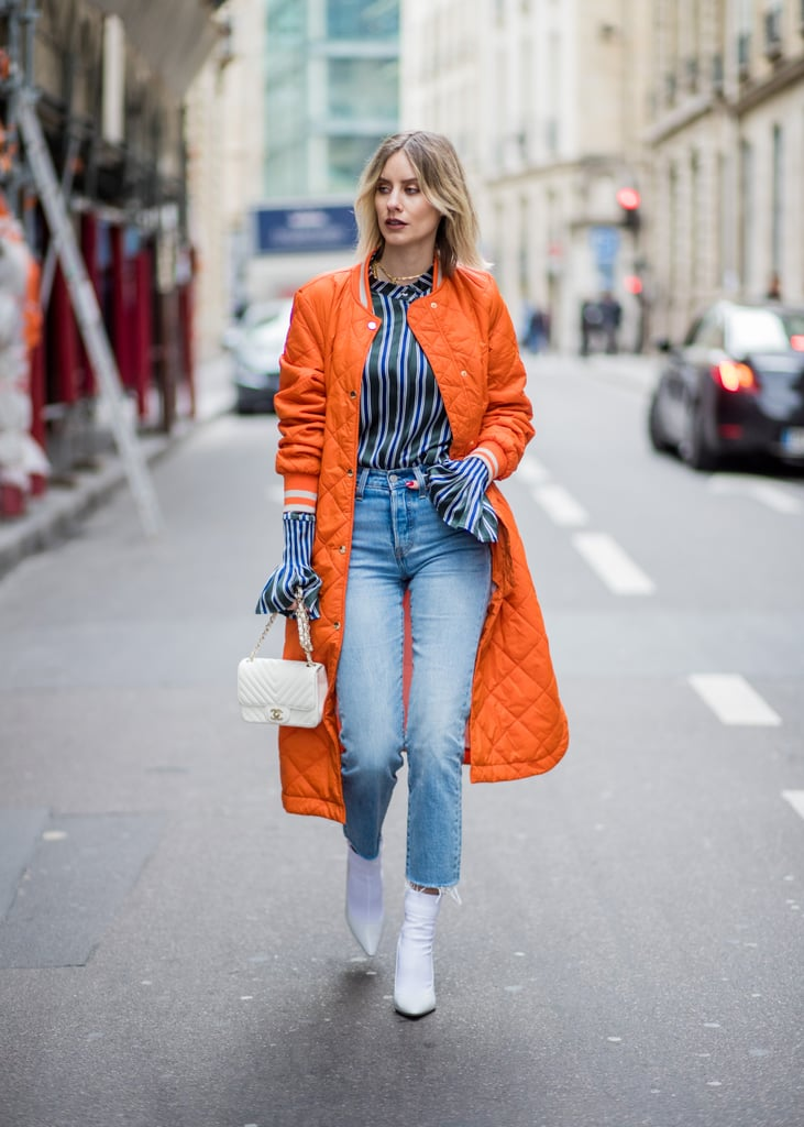 Pair White Boots With a Bright Orange Coat and Mom Jeans