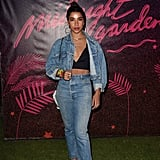 Hannah Bronfman wearing a bustier under a Canadian tuxedo at the Nylon Midnight Garden After Dark party.