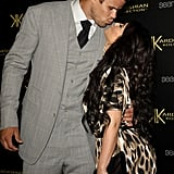Kim Kardashian planted a smooch on Kris Humphries at the Kardashian Kollection launch party in LA in August 2011.