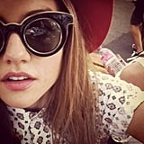 We don't know what we like better: Isabelle Cornish's hat, retro sunnies, cute shirt or just her divine skin and pout? Source: Instagram user isabellecornishh