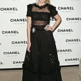 Wearing a black sheer dress to Chanel's Nuits de Diamants (Night of Diamonds) at the Plaza Hotel Grand Ballroom in 2008.