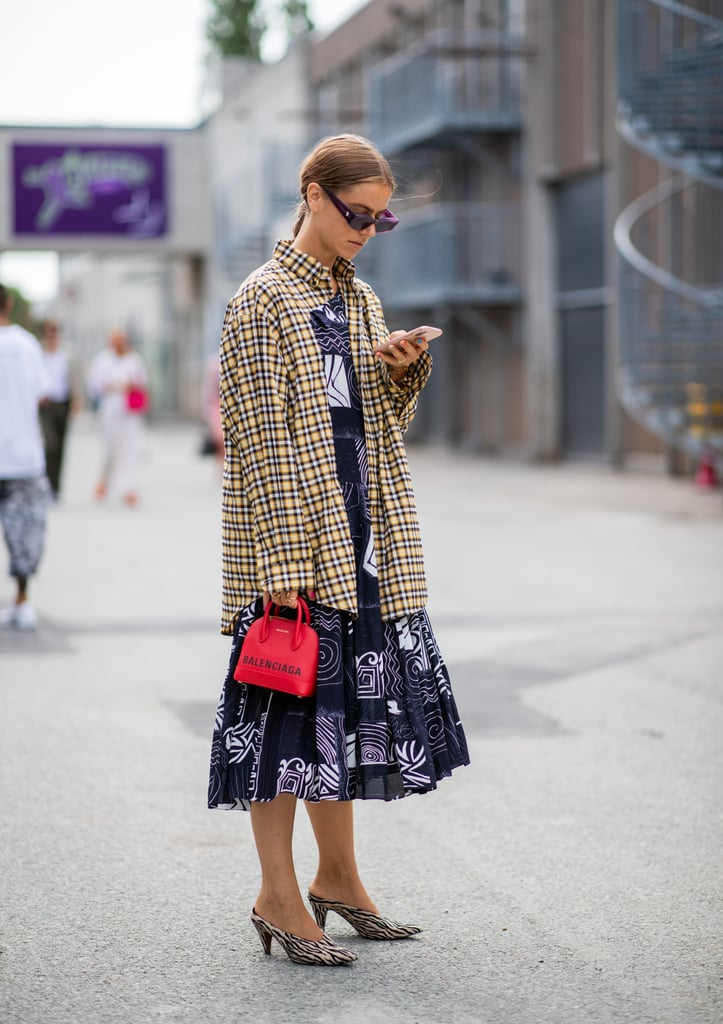 Let a plaid button-down warm up a Summer day dress.
