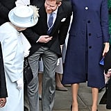 While attempting to hide her baby bump on Princess Eugenie's wedding day, Meghan wore a navy blue Givenchy ensemble with a bespoke Noel Stewart hat.