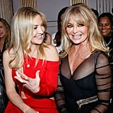 Kate Hudson and Goldie Hawn gave us more adorable mother-daughter moments when the gorgeous duo sat in the front row at the Versace show during Paris Fashion Week on Monday.