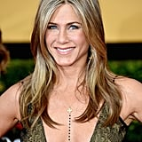 POPSUGAR: How often do you wash your hair, and do you rely on dry shampoo after a workout? Jennifer Aniston: Dry shampoo has kind of been my lifesaver in the last few months. After I work out I usually run a hair dryer through my hair just to kind of dry up the moisture. Then I add the dry shampoo as sort of an added cleanser. It sounds bizarre, but it's actually better day two and day three. It's weird with the dry shampoo, it just kind of gives it more texture and nice, beachy movement. PS: Do you have a technique you use to spray it on?  JA: It's kind of hard to describe it . . . I'm acting it out with my hands. You kind of like part it, spray it, and keep parting it all over your crown and the sides of your head. Then I put a hair dryer through it to air it out and piece it out.