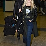 Michael Bublé and his wife walked through the airport.