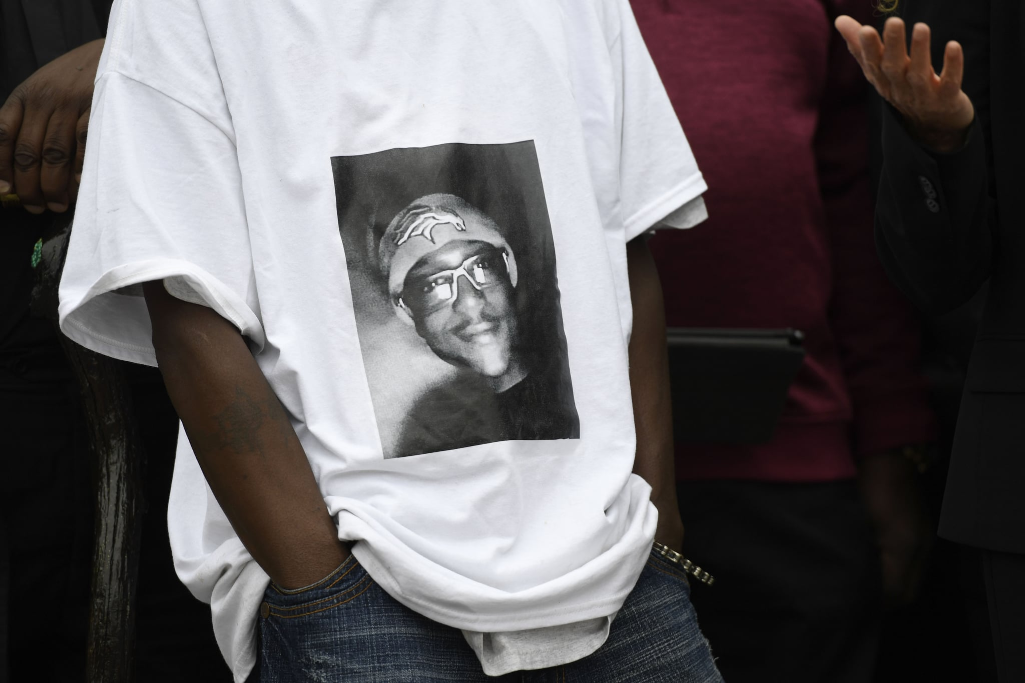AURORA, CO - OCTOBER 01: LaWayne Mosley, father of Elijah McClain, wears a t-shirt with is son's picture on it during a press conference in front of the Aurora Municipal Centre October 01, 2019. Family, friends, legal counsel, local pastors and community organisers were calling for justice for the officer-involved death of his son Elijah McClain in front of the Aurora Municipal Centre October 01, 2019. Elijah was confronted by Aurora police officers in a 911 complaint August 24, 2019, a violent struggle ensued, Elijah became unconscious in the the struggle. While being transported to a hospital, he had a cardiac arrest. Elijah McClain died August 30th, 2019 after he was taken off life support. (Photo by Andy Cross/MediaNewsGroup/The Denver Post via Getty Images)