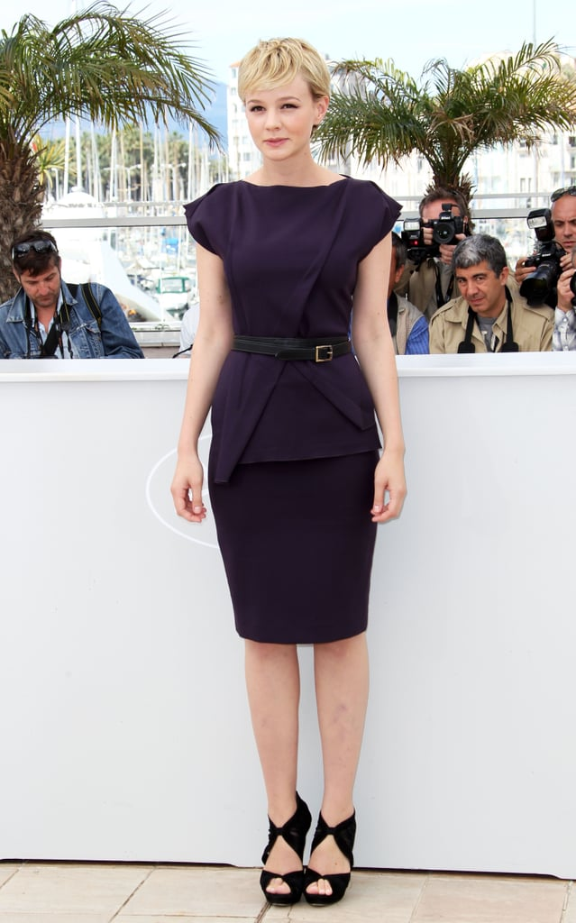 Carey hit Cannes in a structured eggplant sheath, by Roland Mouret, cutout suede Fendi sandals and a double-wrap leather belt.