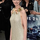 Anne Hathaway arrived wearing a backless dress to the Dark Knight Rises premiere.