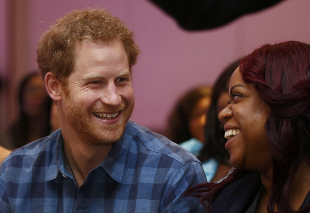 Prince Harry could not have looked any happier while visiting NAZ, a sexual health charity, in London on Tuesday. The young royal continued his bid to promote HIV awareness by meeting with members of the Joyful Noise Choir and encouraging them to not be scared of the stigma attached to their disease. Harry kept things casual for his visit, sporting a blue flannel shirt and the same beaded bracelet his girlfriend, Meghan Markle, has also been photographed wearing. His latest appearance comes just a few days after Harry linked up with Princess Charlene of Monaco at a rugby match between England and South Africa in London. It was also reported that Meghan paid him a short visit over the weekend after she was spotted grocery shopping near Kensington Palace, so perhaps Meghan is the reason for his smile?      Related:                                                                                                           Who Is Meghan Markle? Get to Know the Suits Star Who May Have Stolen Prince Harry's Heart