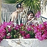 Justin and Selena sat by the pool together.