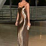 Nicole Richie was a golden girl in a metallic slip dress by Marc Jacobs Collection, Jennifer Meyer earrings, and a Christian Louboutin clutch.