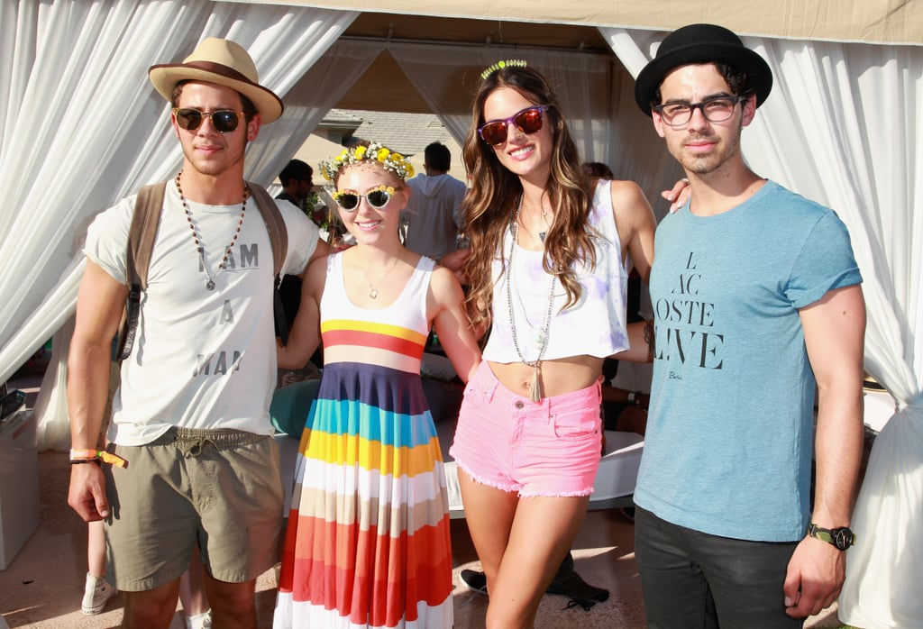 Nick Jonas, AnnaSophia Robb, Alessandra Ambrosio, and Joe Jonas took a photo.