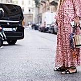 Style your favourite maxi dress with black sandals and a basket bag.